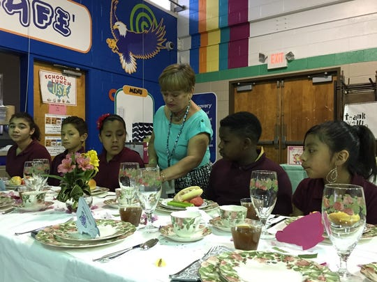 """Gladys Lugardo-Hemple instructs her """"Step 2 Success"""" etiquette club students."""