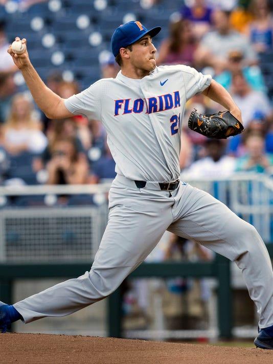 636339456976609304-AP-CWS-Florida-TCU-Baseball-.jpg