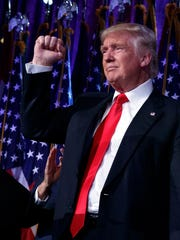 In this Nov. 9 file photo, President-elect Donald Trump pumps his fist during an election night rally  in New York.