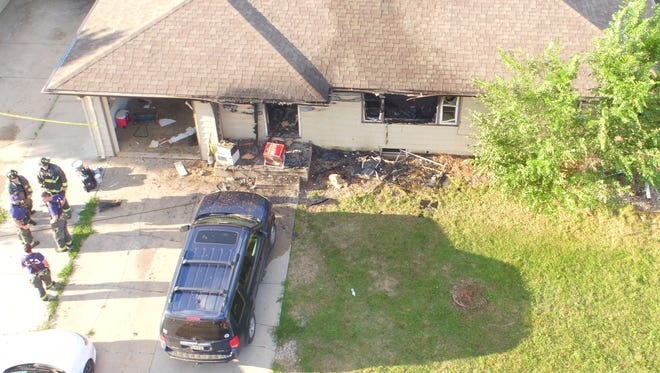 Poudre Fire Authority firefighters investigate a house fire that displaced five men and killed a dog at 1817 Broadview Place on Aug. 20, 2017. This photo was taken using a drone from the Larimer County Unmanned Aircraft System program.