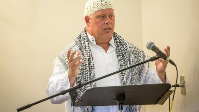 Richard McKinney leads afternoon prayer at the Islamic Center on West Hessler Road Thursday afternoon during Ramadan.
