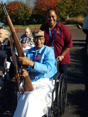"""Marine Corps veteran Hugh Browne, with his daughter Leslie Browne, enjoys the """"Welcome Home"""" celebration Sunday at Mount Laurel Center."""