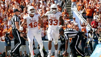 Texas Longhorns running back D'Onta Foreman (33) and tight end Caleb Bluiett (42) celebrate a touchdown in the second quarternagainst the Oklahoma Sooners at Cotton Bowl.