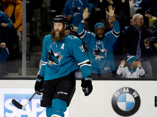 FILE - In this Dec. 21, 2017, file photo, San Jose Sharks center Joe Thornton smiles after scoring against the Vancouver Canucks during the first period of an NHL hockey game in San Jose, Calif. The Sharks face the Anaheim Ducks in the first round of the Stanley Cup playoffs. (AP Photo/Marcio Jose Sanchez, File)