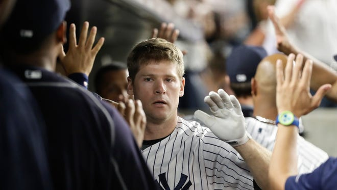 New York Yankees' Chase Headley, celebrates with teammates after hitting a two run home run during the eighth inning of a baseball game against the Baltimore Orioles Tuesday, July 19, 2016, in New York. The Yankees won 7-1.