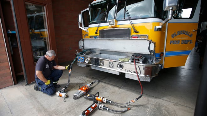 Glendale firefighter Chris Solarez inspects a truck as part of the daily maintenance check at Fire Station 157 in Glendale on May 14, 2015.