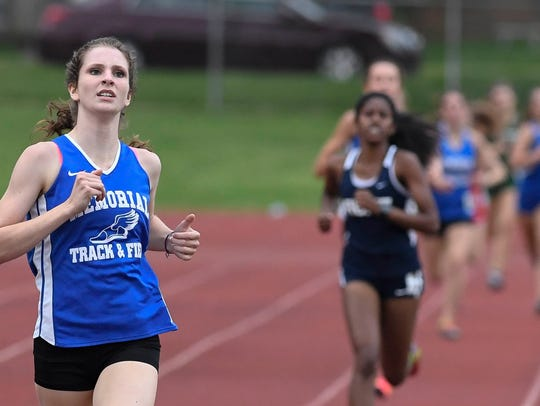 Memorial's Claire Sievern crosses the finish line to