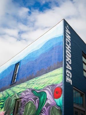 A mural covers the outside of The Anchorage's building in Greenville.