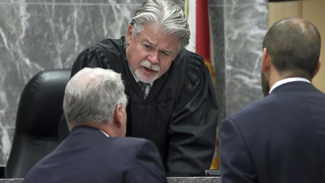 Broward Circuit Judge Dennis Bailey, pictured in a 2019 trial in Fort Lauderdale, Florida, is asking attorneys to get out of bed and put on some clothes when they show up for court hearings on Zoom during the pandemic. He complained that one male lawyer appeared shirtless and a female attorney was still in bed and under the covers.
