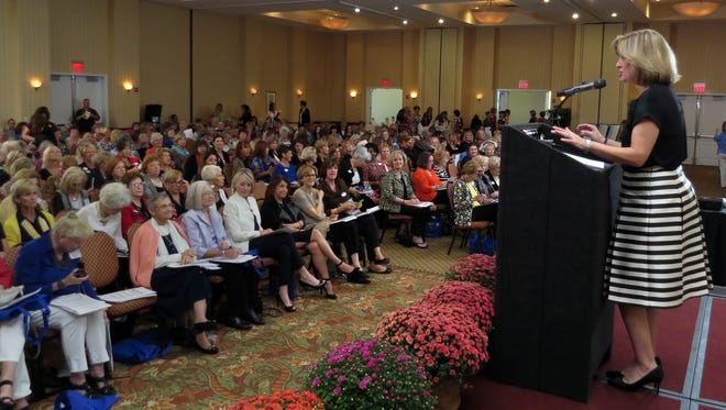In this file photo, Pensacola Bay Area IMPACT 100 President Holly Jurnovoy addresses the membership during the group's 2014 meeting.