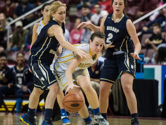 Northern Lebanon's Zoe Zerman fights her way through Briana Breski, of Bishop McDevitt,  and Olivia Fasick, of Bishop McDevitt,  as Northern Lebanon won the PIAA District 3 4A Championship 46-44 over Bishop McDevitt at the Giant Center on Friday, March 3, 2017.