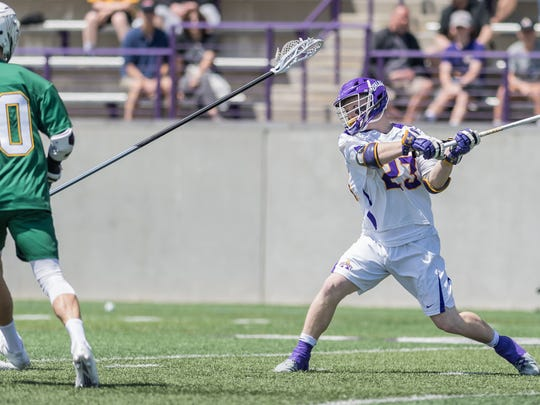 Albany's Jack Burgmaster unloads a shot during Saturday's America East men's lacrosse championship game vs. visiting Vermont.