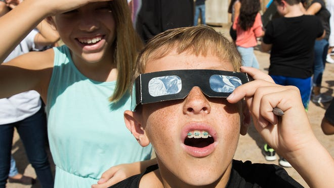 Randy Bailey, 11, a sixth-grader at Vista Middle School, uses ISO Eclipse Glasses to view the start of the solar eclipse, Monday Aug. 21, 2017. In Las Cruces, the eclipse was only 66 percent visible, In a band from Oregon to South Carolina, viewers got to see a total eclipse.