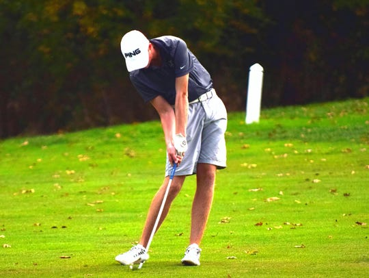 Robert E. Lee's Thomas Otteni hits an iron from the