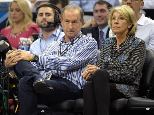 Dick DeVos, center, son of Orlando Magic Chairman Richard