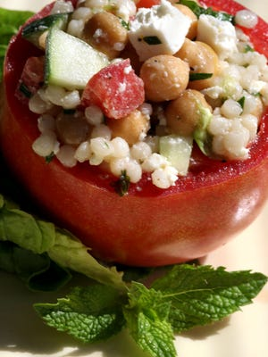 Israeli couscous stuffed tomatoes.