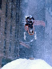 """Winter Gravity Games snowmobiling star Jay Quinlan performs freestyle snowmobiling stunts on West 53rd Street outside the Ed Sullivan Theater during  the 'Late Show with David Letterman' on Monday, Feb. 28, 2005 on the CBS Television Network. (Jeffrey R. Staab/CBS)"""
