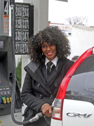 Pamela Kitchener of North White Plains fills her car Monday at a gas station in New Rochelle, where the price of regular gas was $2.85 a gallon.
