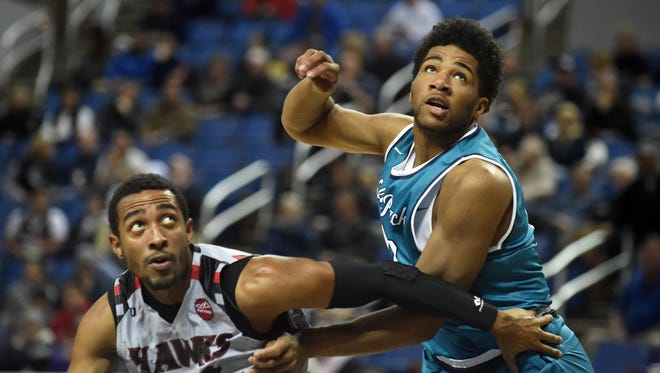 Nevada's Elijah Foster, right, and Holy Names' Dante Robinson battle for a rebound during the 2015 season.