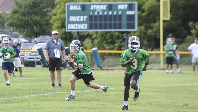 Christ School quarterback Drew Johnson, left.