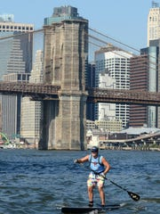 Edmonds Bafford, SEA Paddle NYC board member and fundraiser, paddling in the race.