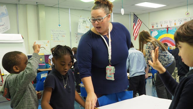 Melanie Quill leads first graders in math Tuesday at Shortlidge Academy in Wilmington. Shortlidge is a priority school that now serves children in preschool through second grade.