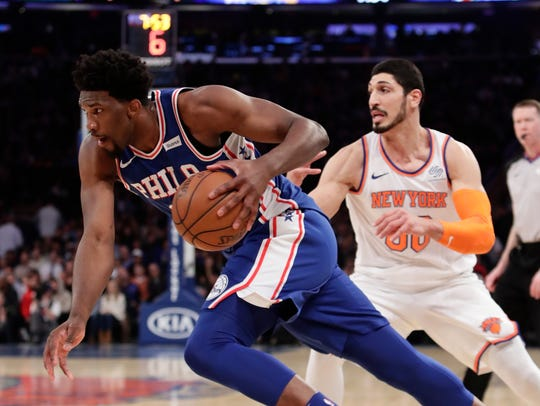 Philadelphia 76ers' Joel Embiid (21) drives past New