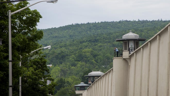 A guard looks out from a tower at the Clinton Correctional Facility in Dannemora, N.Y.