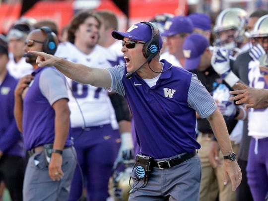 Washington coach Chris Petersen yells instructions to his team during the second half against Utah.
