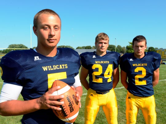 Woodmore quarterback Connor Bringman and teammates Dustin Haar (24) and DJ Wellons (2) look to lead the Wildcats' offense as a balanced attack in 2015.