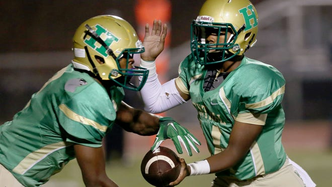 Rashad Haynes of Central (left) is the offensive player of the year in Region 8-5A.