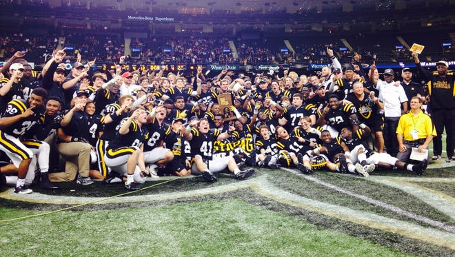 Neville celebrates the Class 4A state championship with a 28-27 win over Warren Easton.