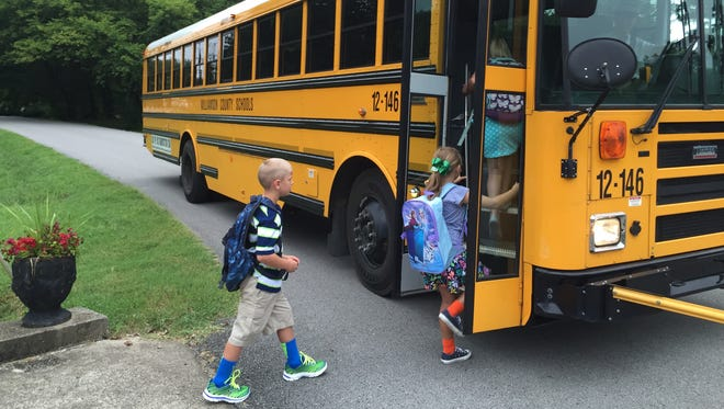 Elementary students board a Williamson County school bus on the first day of school. The district is recruiting more bus drivers to alleviate a shortage.