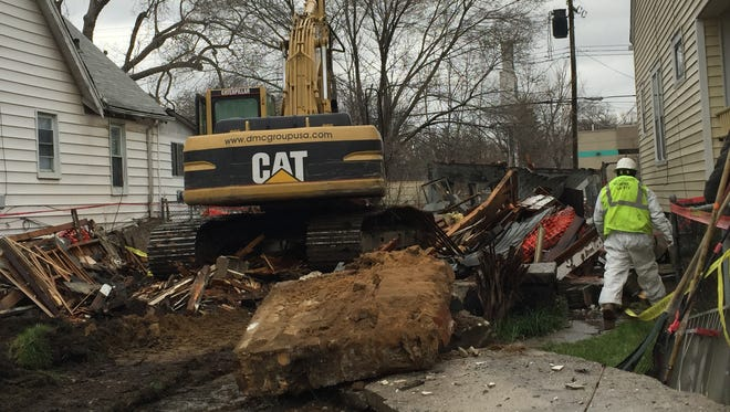 A city crew with the Detroit Land Bank worked to demolish the remains of a home at 20194 Stoepel in Detroit on March 28, 2016.