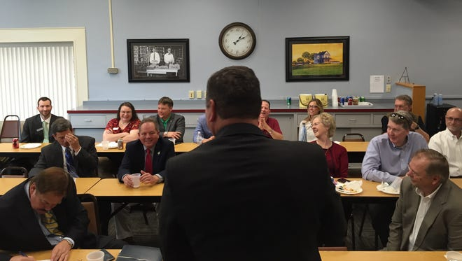 Maryland Agriculture Secretary Joe Bartenfelder, foreground, speaks to a group of politicians and business leaders Wednesday, May 11, at the Salisbury Area Chamber of Commerce.