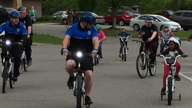 Riders, including Mansfield police, Explorers and young bicyclists, take off on the Richland B&O Trail during Bike-a-Palooza on Saturday.