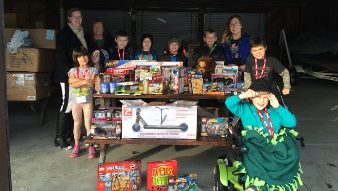 Special education students from Vesper Community Academy pose with toys they purchased for the local Toys for Tots drive. The students hosted a penny war at the school and raised $692.49.