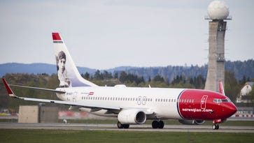 A Boeing 737-33S operated by Norwegian Air Shuttle sits on the tarmac at the Oslo Airport Gardemoen on May 2, 2014. Norwegian announced Thursday flights from Boston, New York and Baltimore-Washington to the Caribbean starting Dec. 3.