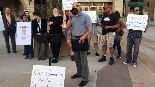 Protesters gather outside the Bernalillo County Courthouse in Albuquerque, N.M., on Tuesday, Oct. 11, 2016, after a judge declared a mistrial against two former Albuquerque police officers facing murder charges in the 2014 fatal shooting of a homeless man.