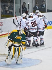 St. Cloud State players celebrate one of three first