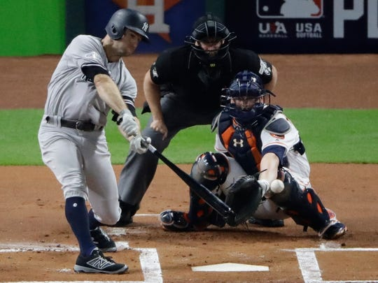New York Yankees' Brett Gardner hits a single during