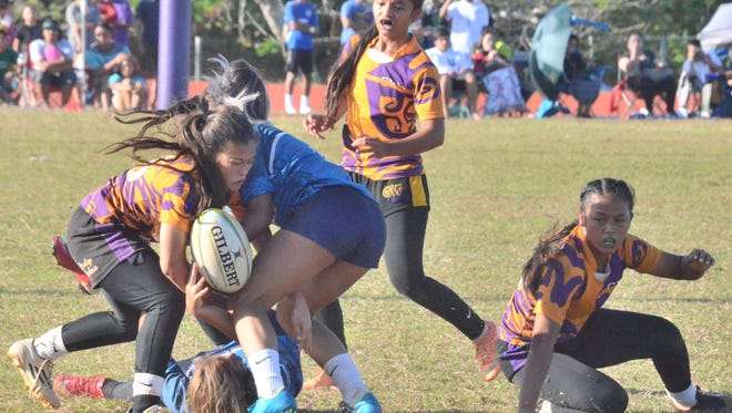 In this file photo, the George Washington Geckos beat the Notre Dame Royals 26-0 to claim their fifth straight IIAAG girls rugby championship.