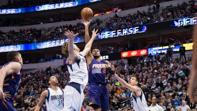 Jan 5, 2017; Dallas, TX, USA; Phoenix Suns guard Leandro Barbosa (19) shoots over Dallas Mavericks forward Dirk Nowitzki (41) and forward Nicolas Brussino (9) during the second quarter at the American Airlines Center.
