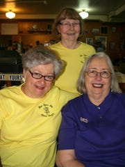 Bottom row from left, Connie McIntire and Jan Meranda, joined with Angie Warren, top row, at Holding Court to discuss an 84-year-old winning way to make new friends, the Beta Sigma Phi women's organization.