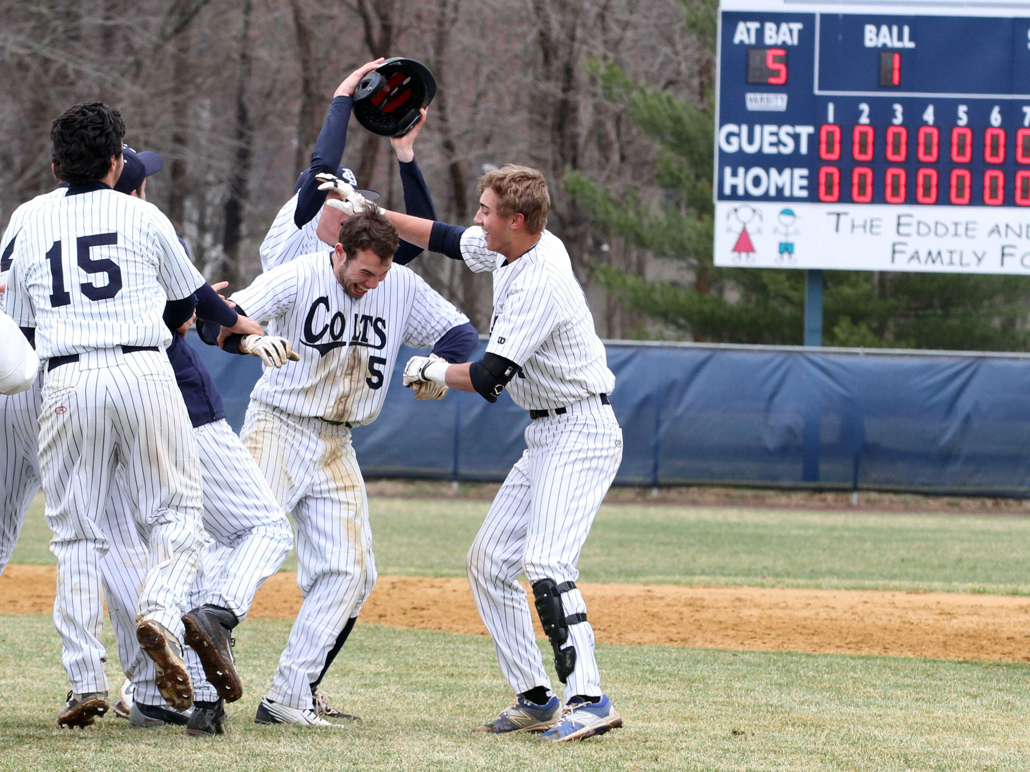 Christian Brothers Academy's Will Morgan (No. 5) is congratulated by his teammates after he drove in the winning run in the bottom of the eighth inning of CBA's 1-0 win over Marlboro on Thursday
