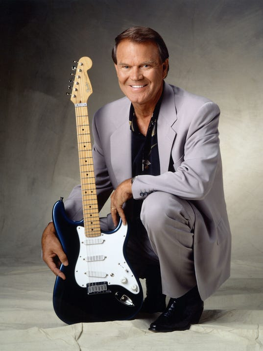 636378724913692297-1.-Glen-Campbell-in-later-years-with-guitar.jpg