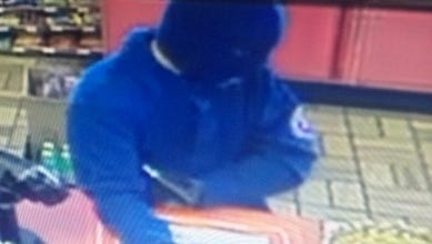 Video surveillance footage from the Murfreesboro Market shows a masked man who displayed a black semi automatic handgun and demanded money from the business and employees. Anyone with information can call the CID at 615-893-2717 or Crime Stoppers at 615-893-STOP(7867).