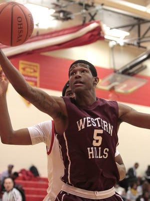 Delon Montgomery of Western Hills grabs an offensive rebound before it heads out of bounds against North College Hill.