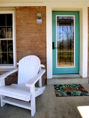 The home of Wanda and Darnell Thompson on Tuesday, Jan. 19, 2016. The home has been completely renovated. Two adirondack chairs and a flowered welcome matt is at the front door of the Thompson home.