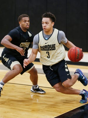 Carsen Edwards drives the baseline against P.J. Thompson during Purdue men's basketball practice Tuesday, July 26, 2017, on Cardinal Court.
